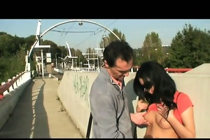 brunette hair acquires wang in public place