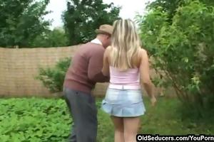 fucking on a green garden lawn